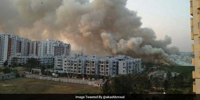 Smoke rises from the Bellandur lake.