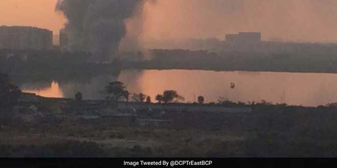 A distant view of the Bellandur lake on fire.