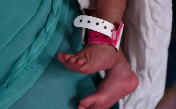 6-Hour-Old Girl, Buried Alive, With Umbilical Cord Intact, Is Recovering