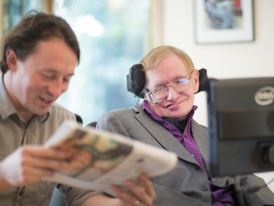 Hawking-and-his-carer-Pete-read-the-paper_small-e1417541606368