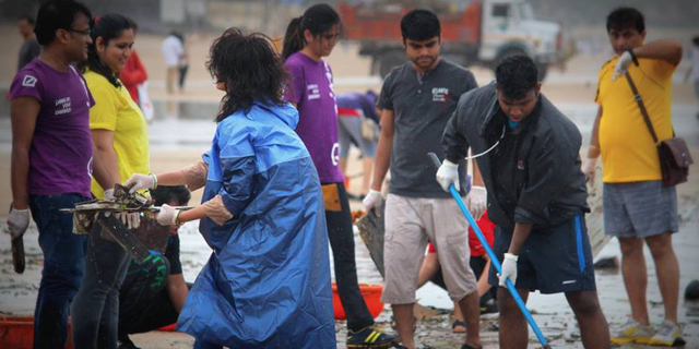 Volunteers collecting puja waste from Mumbai's beaches