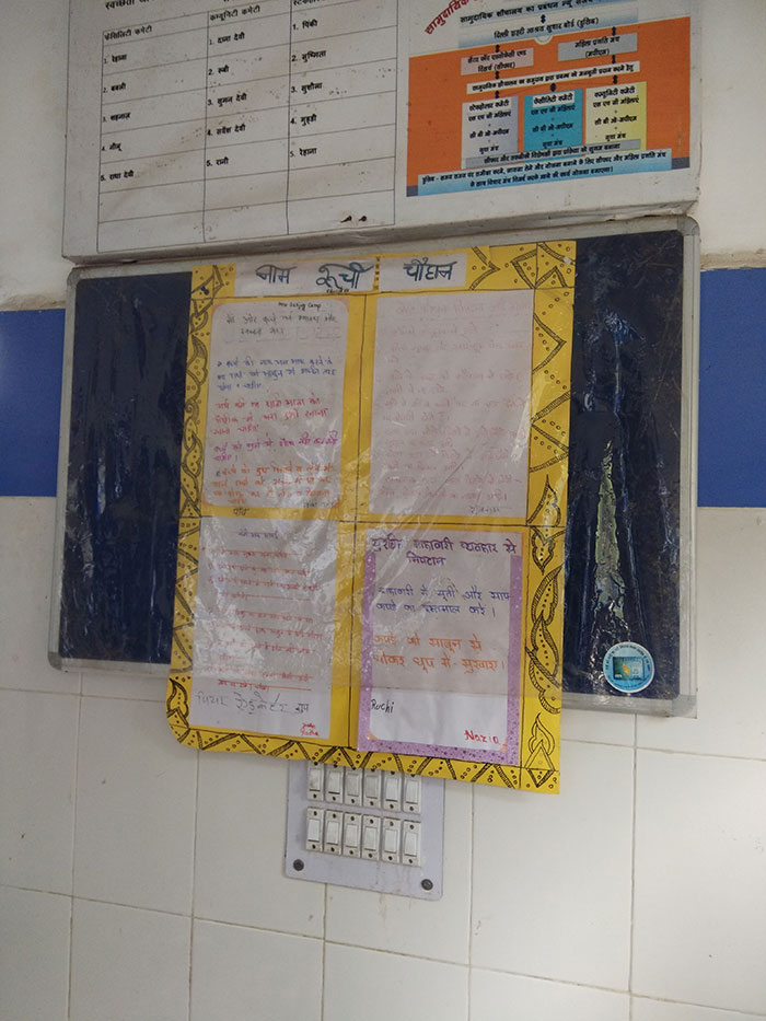 Handwritten newspapers in toilets are placed to make people aware of the benefits of healthy sanitation