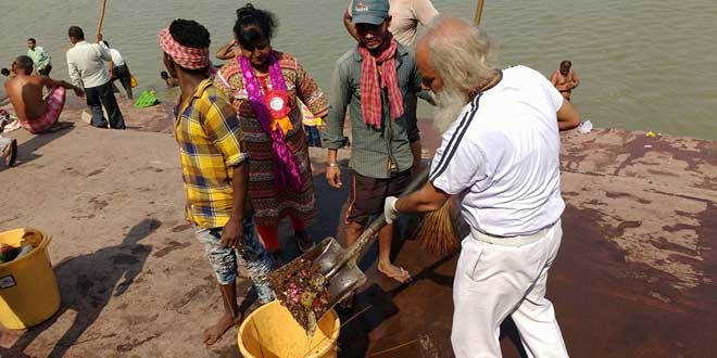Chandra cleaning up the Ganga ghat.