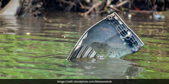 Electronic waste dumped in river.