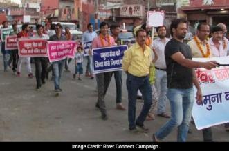 Hundreds of river activists held amarchon Sunday, demanding action against polluters for 'killing'the river Yamuna