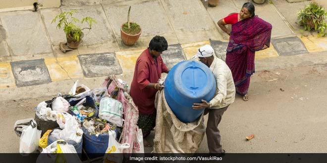 A waste collector in Bengaluru
