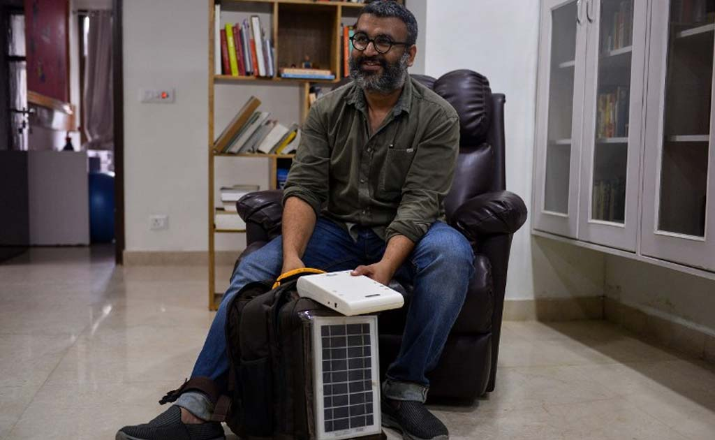 Biomedical engineer Kanav Kahoi speaks holding his invention 'Swasthya Slate' at his home in New Delhi.