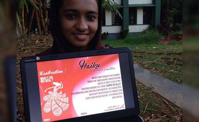 A students displays poster for Haiku on her laptop
