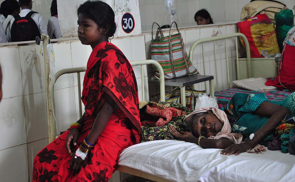 Two patients to a bed is not uncommon in the general ward at the Maharani Medical College in Jagdalpur.