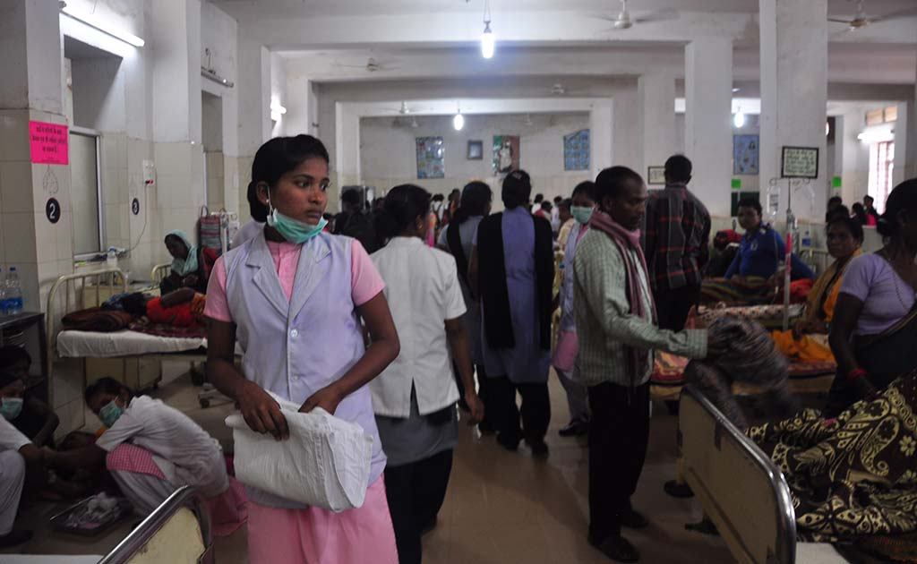 The overflowing general ward in the Maharani Medical College and Hospital, Jagdalpur. This is the Bastar region's biggest hospital.
