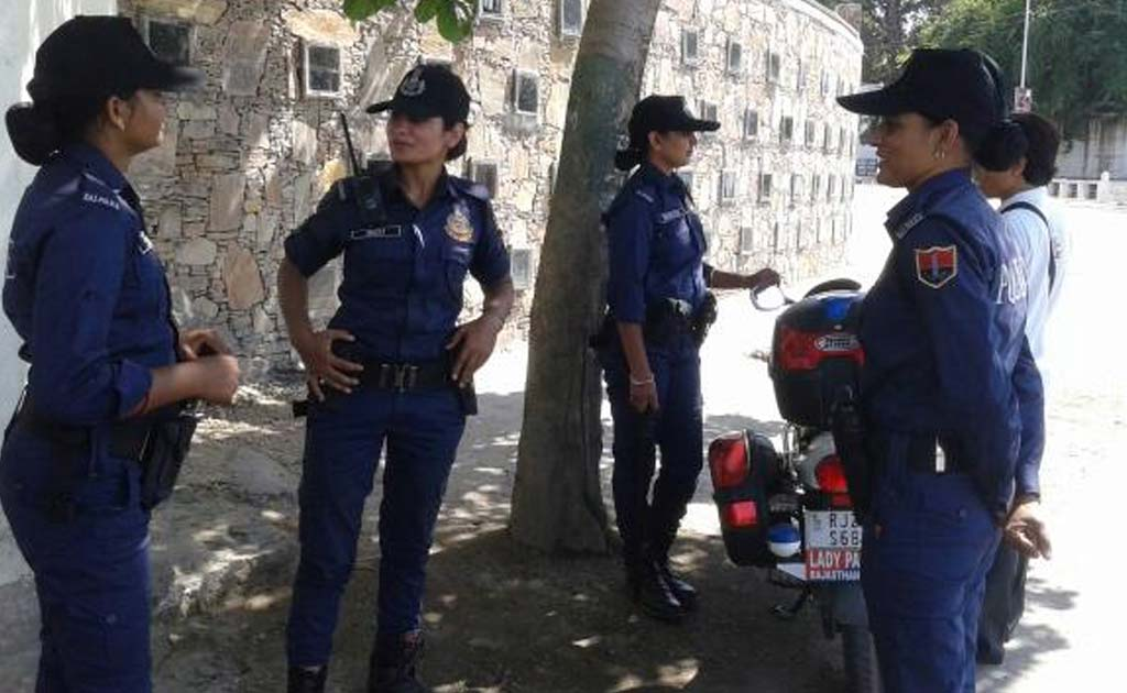 The women, wearing uniforms in blue, similar to the attire of various American police forces like New York Police Department (NYPD).