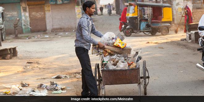 Shopkeeper segregating waste