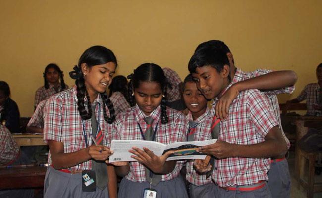 children-studyng-trashonomics_book-on-waste-management