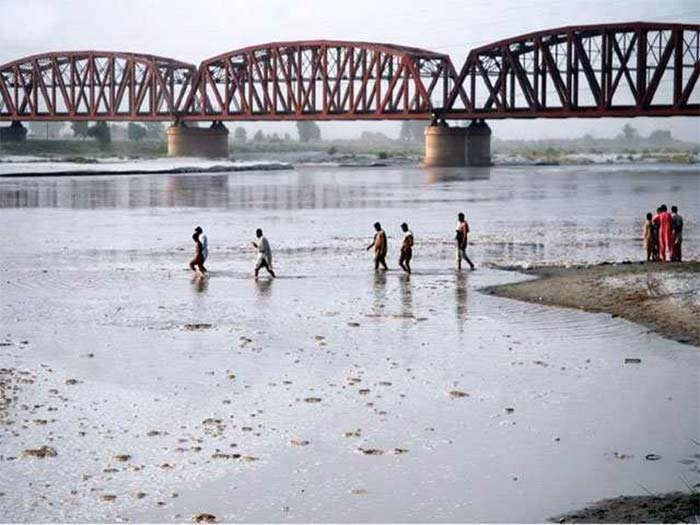Despite the flow of industrial pollutants, people are dependent on river Sutlej