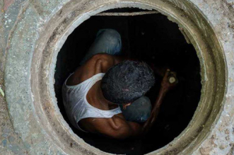 The Delhi government will provide loans to manual scavengers to purchase sewer cleaning machines
