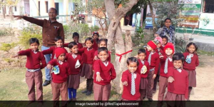 Children In Uttar Pradesh's Firozabad District Vow To Save Trees By Tying A Red Ribbon, Thanks To This Officer