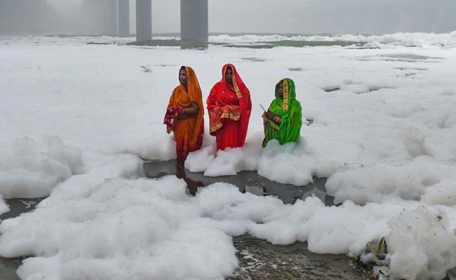Devotees Stand Knee-Deep In Toxic Foam In Delhi's Yamuna For Chhath Puja