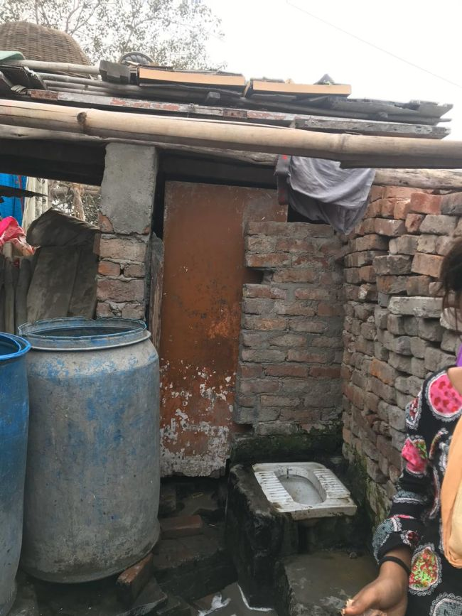 The small toilet built by the slum dwellers inside their slum temporarily; there's no sewage connection for these
