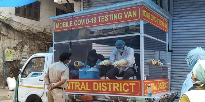Now the people can get tested in this mobile testing van, which is modified in a way that health officials can sit behind a glass casing and collect nasal and the throat swabs of the people