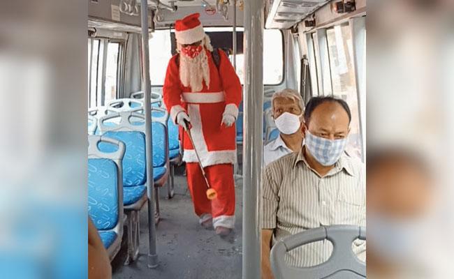 Santa Claus Sanitises Public Places In Mumbai And Distributes Masks