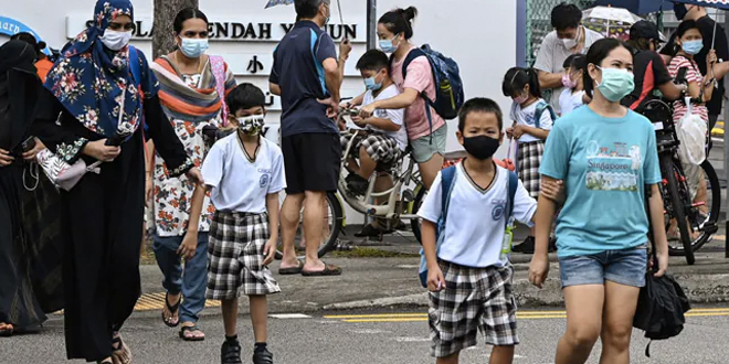 """Singapore Health Minister Ong Ye Kung, citing a conversation he had with the ministry's director of medical services Kenneth Mak, told a news conference Sunday that the B.1.617 strain """"appears to affect children more"""""""