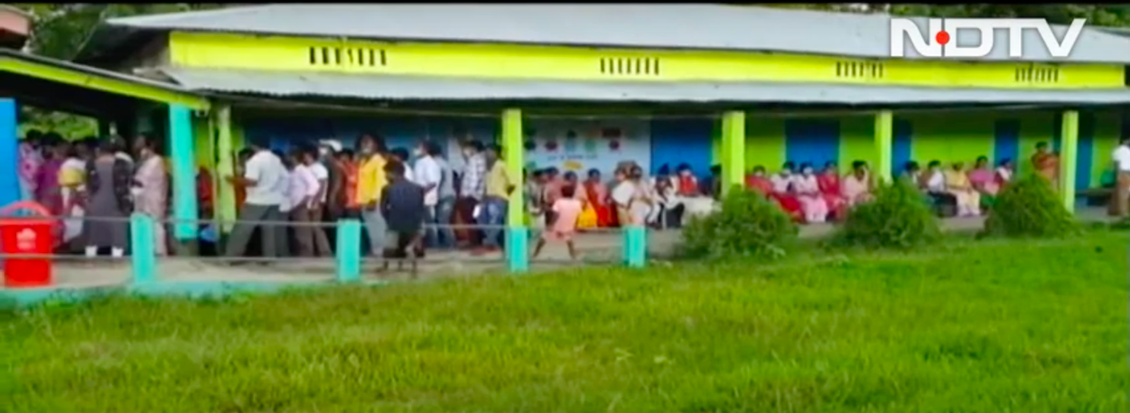 Kamrup metro district, around 60 kilometres east of Guwahati, where people have queued up outside a polling booth to take their COVID-19 vaccine